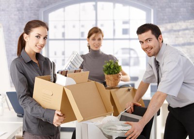 People Packing And Moving Office Supplies